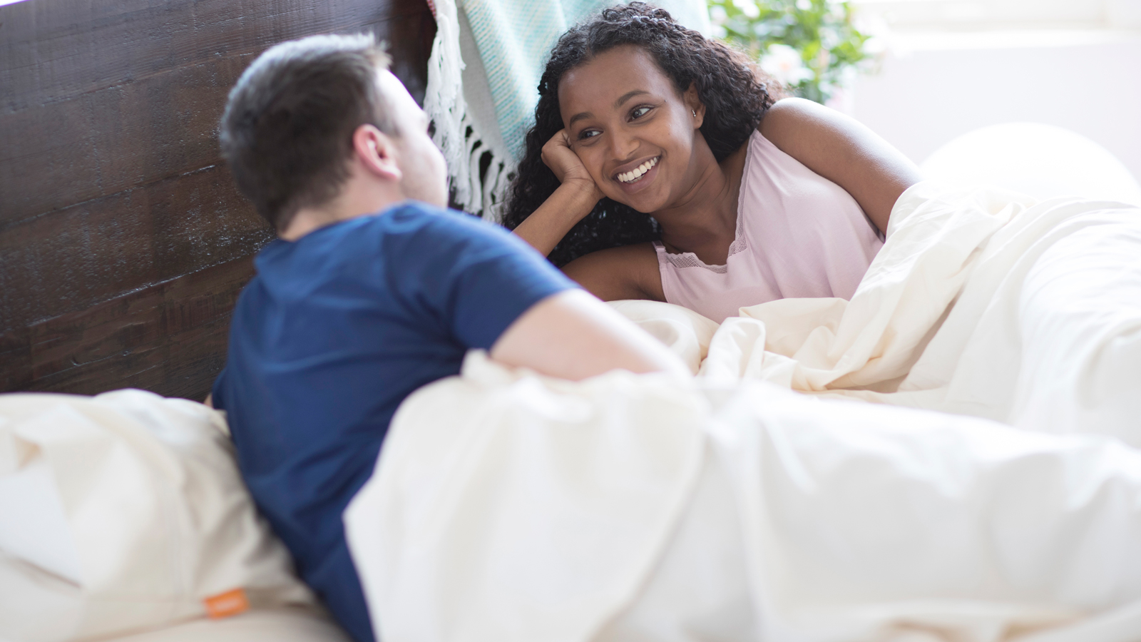Couple on Mattress with Bedding